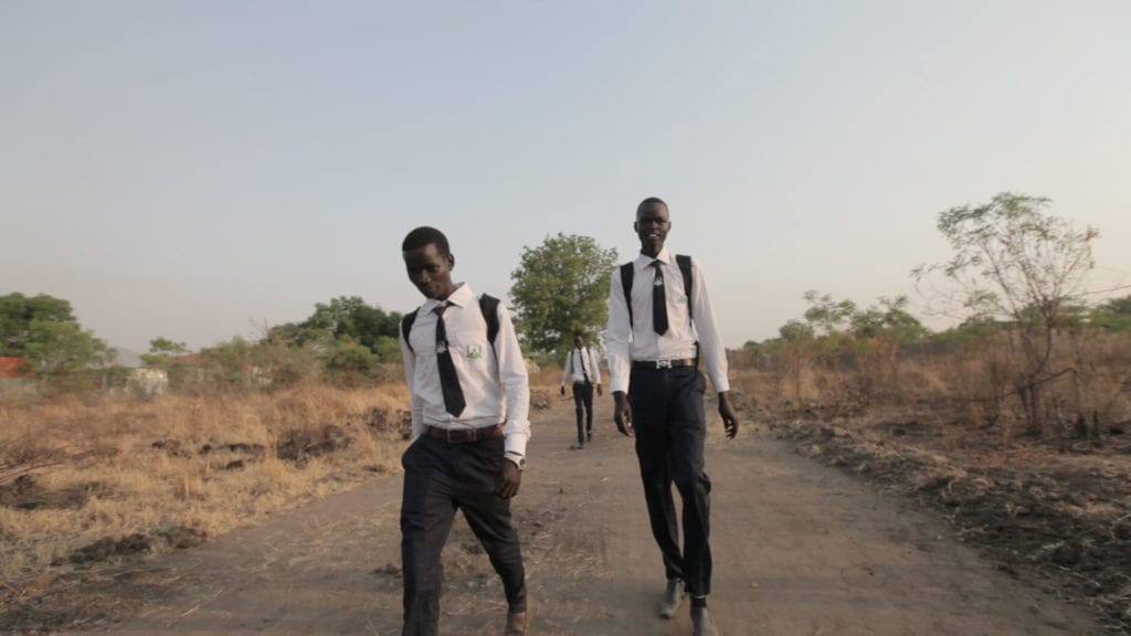 Boys walking to Greenbelt Academy in South Sudan